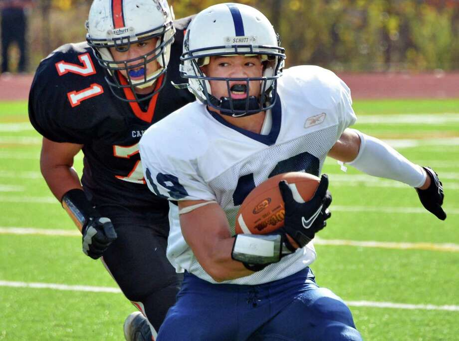 Rensselaer's #19 Brandon Butler races Cambridge' defender #71 Nathan Winchester, left, during Saturday's game at Stillwater High School Oct. 20, 2012.  (John Carl D'Annibale / Times Union) Photo: John Carl D'Annibale / 00019739A