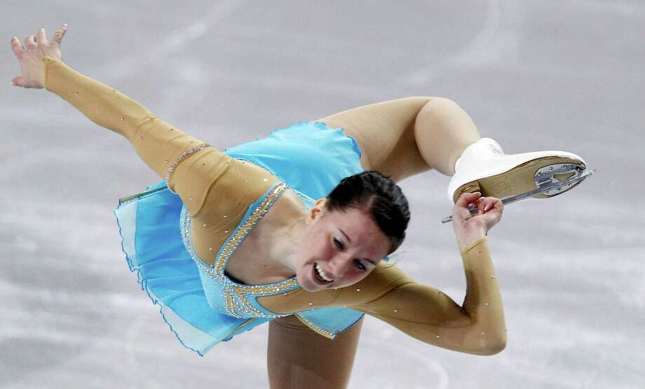 Germany's Sarah Hecken holds onto a skate blade as she spins during the ladies short program. Photo: AP