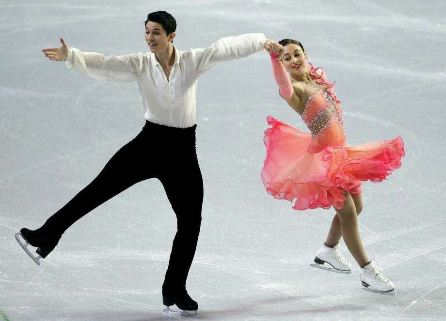 Anastasia Cannuscio, right, and Colin McManus perform during the ice dance short program. Photo: AP