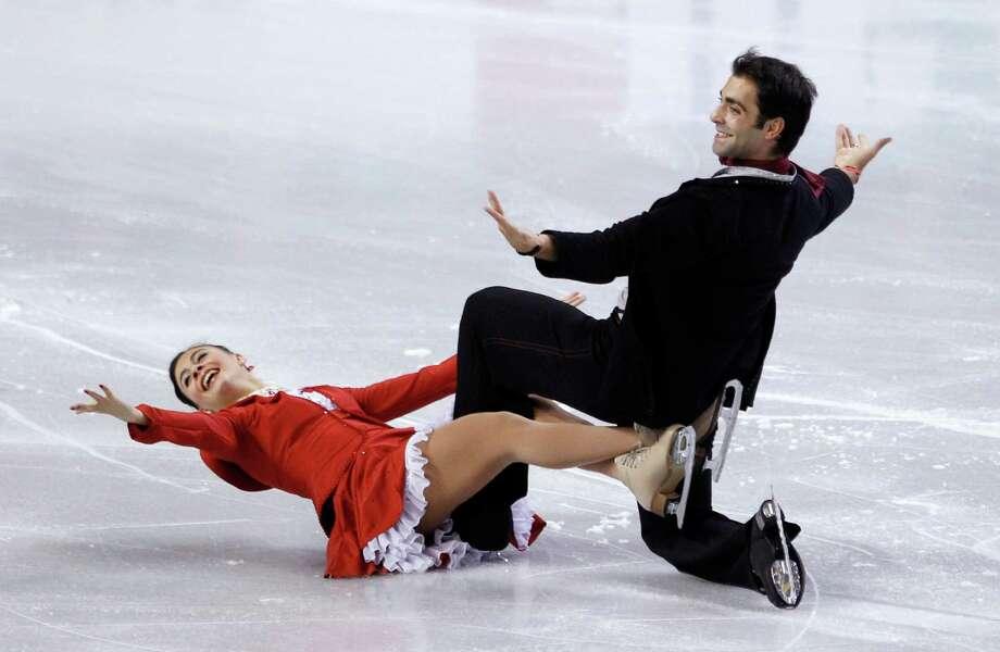 Italy's Lorenza Allessandrini, left, and Simone Vaturi perform during the ice dance short dance. Photo: AP
