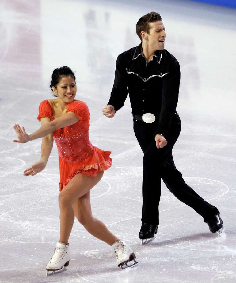 Lynn Kriengkrairut, left, and Logan Giuliette-Schmitt perform during the ice dance short dance. Photo: AP