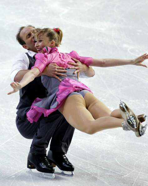 Germany's Nelli Zhiganshina, right, and Alexander Gazi perform during the ice dance short dance.