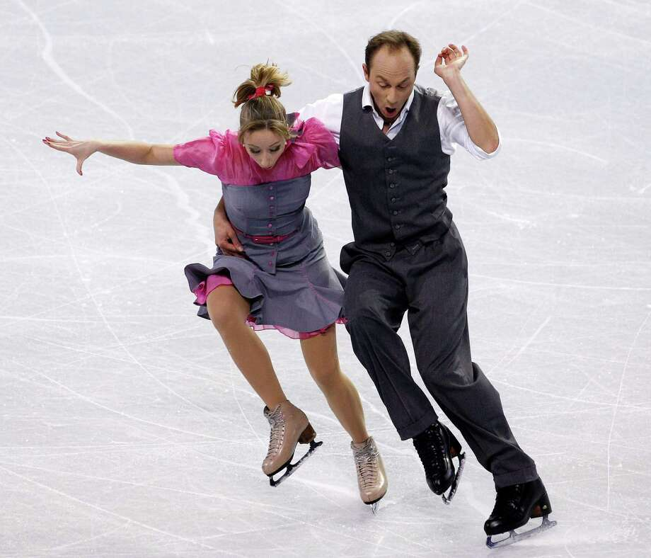 Germany's Nelli Zhiganshina, left, and Alexander Gazi perform during the ice dance short dance. Photo: AP