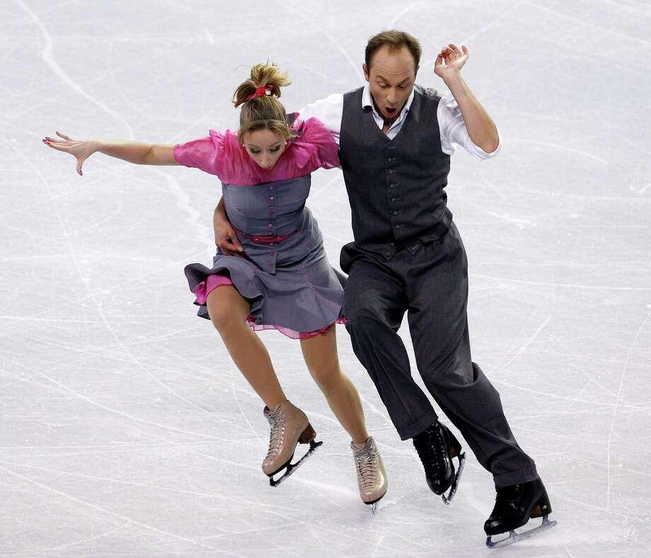 Germany's Nelli Zhiganshina, left, and Alexander Gazi perform during the ice dance short dance. Photo: AP