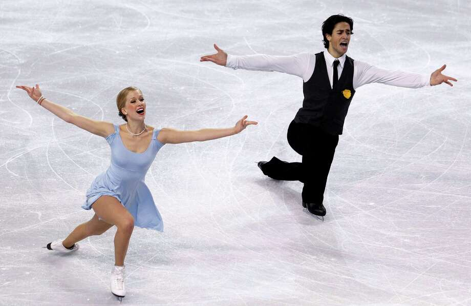 Canada's Kaitlyn Weaver, left, and Andrew Poje perform during the ice dance short dance. Photo: AP