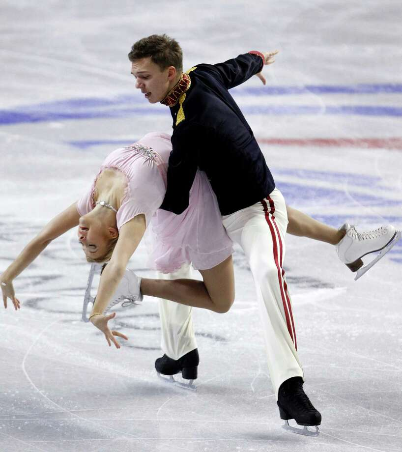 Russia's Ekaterina Bobrova, left, and Dmitri Soloviev perform during the ice dance short dance. Photo: AP