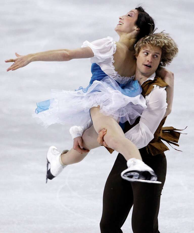 Meryl Davis, top, and Charlie White skate during the ice dance short dance. Photo: AP