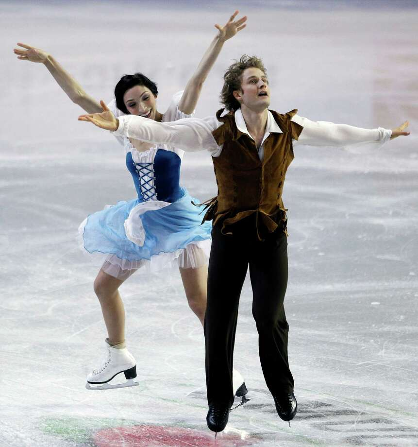 Meryl Davis, left, and Charlie White skate during the ice dance short dance. Photo: AP