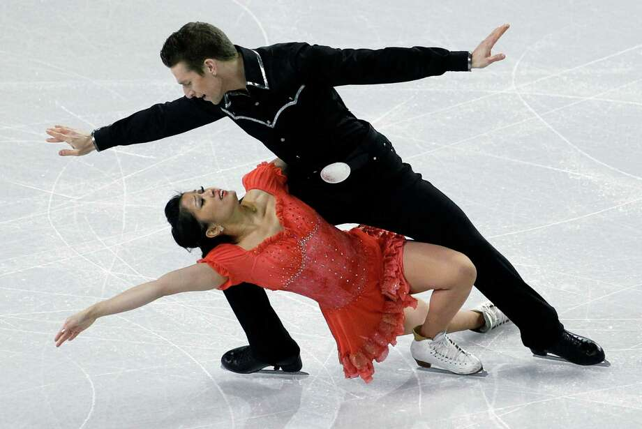 Lynn Kriengkrairut, bottom, and Logan Giuliette-Schmitt skate during the ice dance short dance. Photo: AP