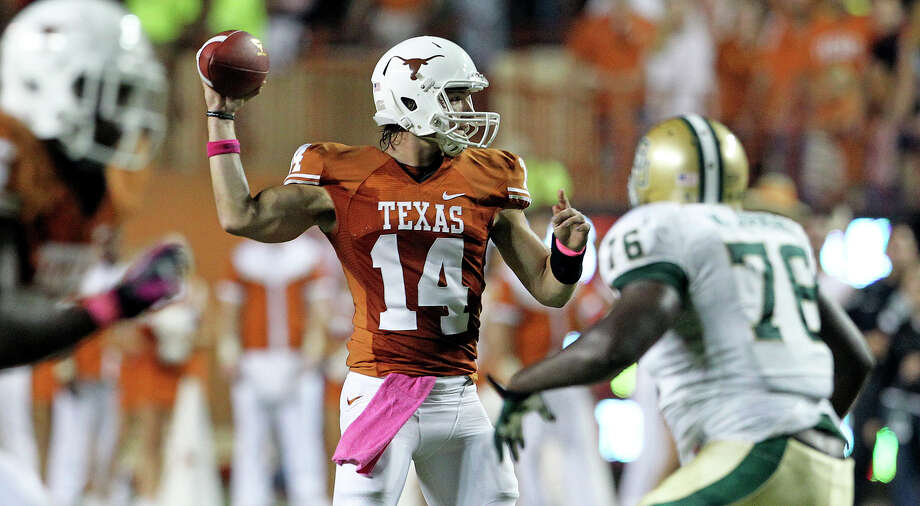 David Ash pumps a shot as Texas hosts Baylor at Darrell K Royal - Texas Memorial Stadium  on Oct. 20, 2012. Photo: Tom Reel, Express-News / ©2012 San Antono Express-News