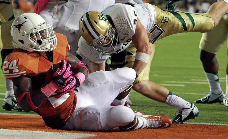 Joe Bergeron rolls into the endzone in the second quarter as Texas hosts Baylor at Darrell K Royal - Texas Memorial Stadium Stadium  on October 20, 2012. Photo: Tom Reel, Express-News / ©2012 San Antono Express-News