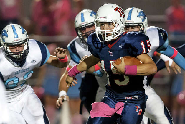 Roosevelt quarterback Jacob Preciado (15) looks for running room on a fourth quarter keeper during their game with Johnson at Heroes Stadium on Oct. 20, 2012.  Roosevelt won the game 34-27 in overtime.  MARVIN PFEIFFER/ mpfeiffer@express-news.net Photo: MARVIN PFEIFFER, Express-News / Express-News 2012