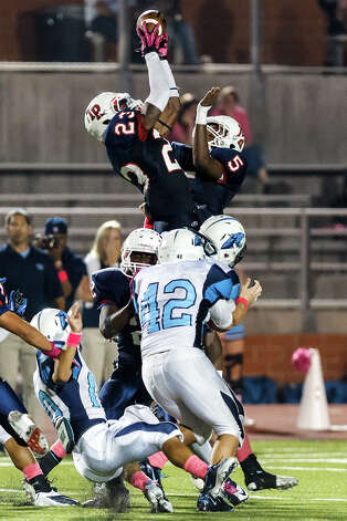 Roosevelt's Carl Whitley (top left) and Gabriel Graham leap to grab an on-side kick by Johnson with 2:44 remaining in their game at Heroes Stadium on Oct. 20, 2012. Roosevelt went on to win the game in overtime 34-27.   MARVIN PFEIFFER/ mpfeiffer@express-news.net Photo: MARVIN PFEIFFER, Express-News / Express-News 2012