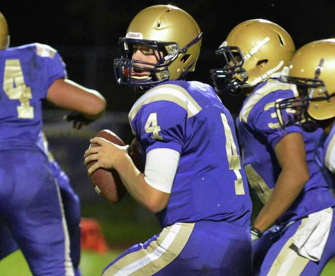 CBA QB #4 Troy Anthony looks downfield for a receiver during Saturday night's Section II football pl