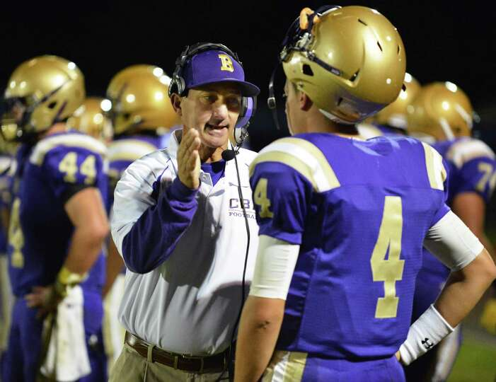 CBA head coach Joe Burke with QB #4 Troy Anthony on the sidelines during Saturday night's Section II