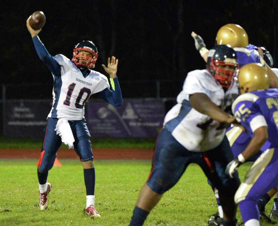 Schenectady QB #10 Kwame Jarvis fires off a pass during Saturday night's Section II football playoff game against CBA in Colonie Oct. 20, 2012. Photo: John Carl D'Annibale, John Carl D'Annibale / Times Union / 00019769A