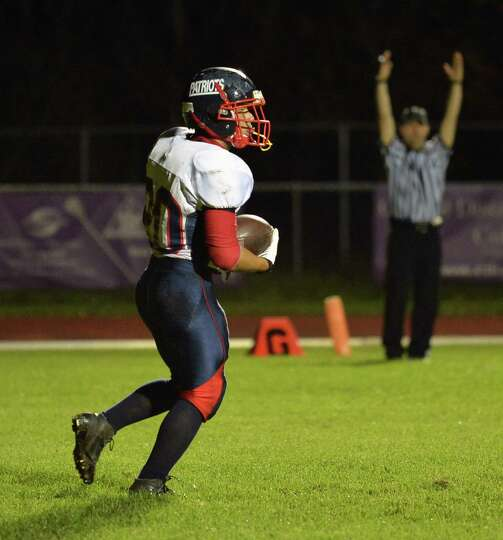 Schenectady's #20 in the end zone after scoring a touchdown in Saturday night's Section II football