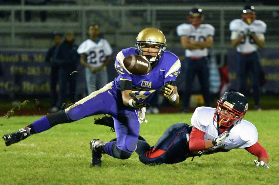CBA #88 Josh Wynn intercepts a pass meant for Schenectady' #20 Felix Rodriquez, at right, during Saturday night's Section II football playoff at CBA in Colonie Oct. 20, 2012. Photo: John Carl D'Annibale, John Carl D'Annibale / Times Union / 00019769A
