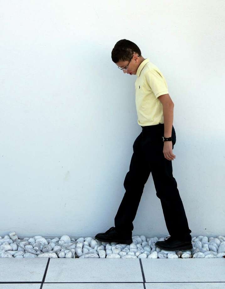 Jake Finkbonner, of Ferndale, Washington, walks on cobblestones prior to an interview with the Associated Press, in Rome, Thursday, Oct. 18, 2012.  Jake was infected with a flesh-eating bacteria in 2006, when he was five years old, and his prognosis was so grave that his parents had last rites performed and were discussing donating his organs. The Vatican determined that Jake's cure was a miracle due to the intercession of Kateri Tekakwitha, a 17th century Native American who is among seven people who will be declared saints on Sunday by Pope Benedict XVI. (AP Photo/Alessandra Tarantino) Photo: Alessandra Tarantino, Associated Press / AP