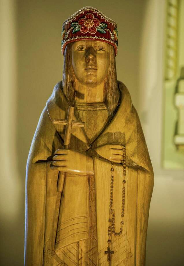 """A statue of Kateri Tekakwitha is seen as her devotion celebrated by the Catholic faithful October 21, 2012 at the St. Francis Xavier Church in Kahnawake, Quebec, Canada. Pope Benedict XVI named seven new saints on Sunday, including the first Native American, praising their """"heroic courage"""" as the Catholic Church seeks to counter a rising tide of secularism in the West. Kateri Tekakwitha, known as """"Lily of the Mohawks"""", who for centuries has been a symbol of hope for the long-oppressed American Indians, was canonised in a lavish ceremony in St Peter's Square that followed her beatification in 1980 by the late pope John Paul II.   AFP PHOTO / ROGERIO BARBOSAROGERIO BARBOSA/AFP/Getty Images Photo: ROGERIO BARBOSA, AFP/Getty Images / AFP"""