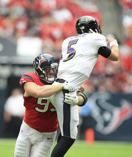 Houston Texans defensive end J.J. Watt (99) tries to sack Baltimore Ravens quarterback Joe Flacco (5