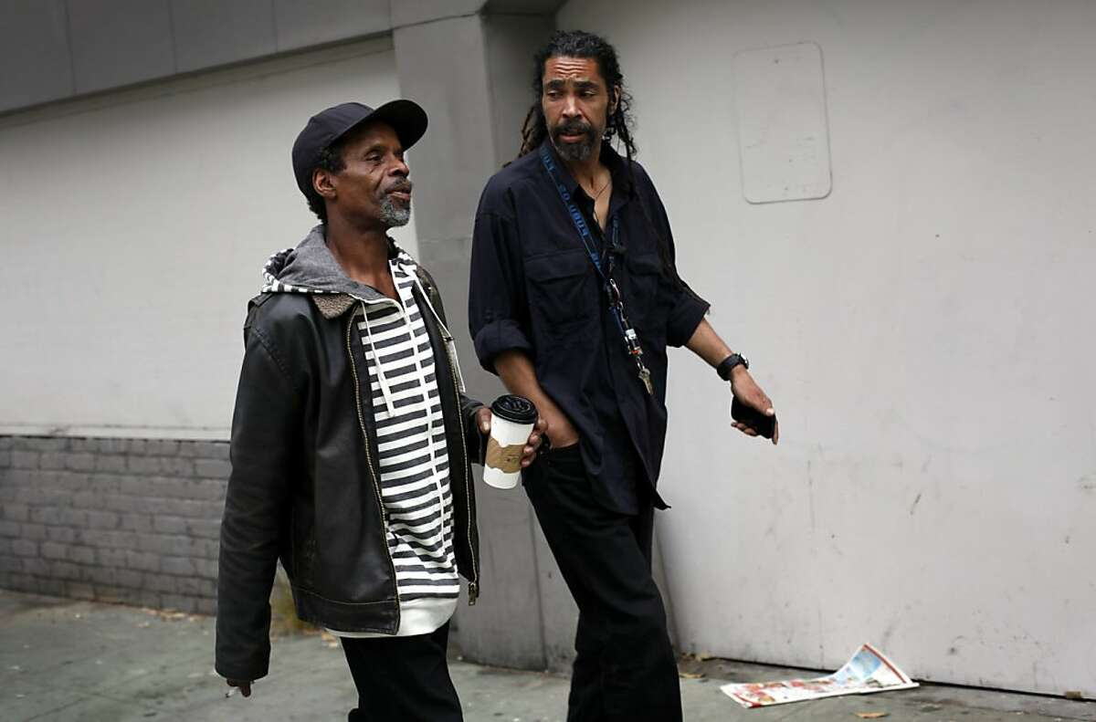 Tony Beliso, right, walks client Craig Dickerson over to his meeting with a caseworker in San Francisco, Calif., Friday, October 19, 2012. Dickerson is a participant in San Francisco's pretrial program, where defendants who have not had their day in court do not have to wait in jail. Dickerson is homeless and trying to get disability to find better housing. Beliso makes sure his clients attend all of their appointments.