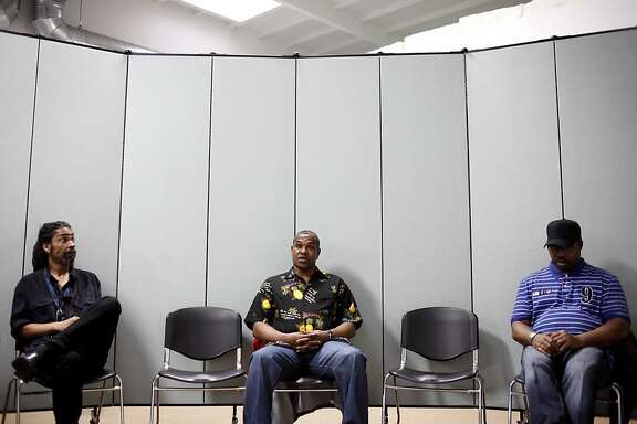 David Jones, center, gives a status update during a group session in the pretrial program in San Francisco, Calif., Friday, October 19, 2012.  Listening at right is group member Earnest Gray, and at left is outreach coordinator Tony Beliso.  The pretrial program allows defendants who have not had their day in court to not have to wait in jail.