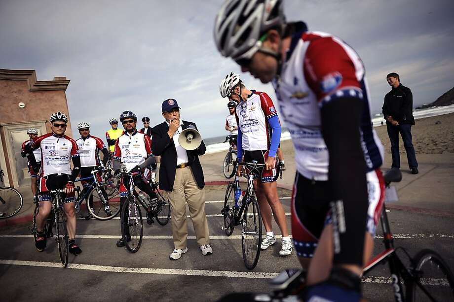 Lawrence Gonzales (center), undersecretary of the California Veterans Affairs, prepares the bikers to begin the coastal ride. Photo: Michael Short, Special To The Chronicle