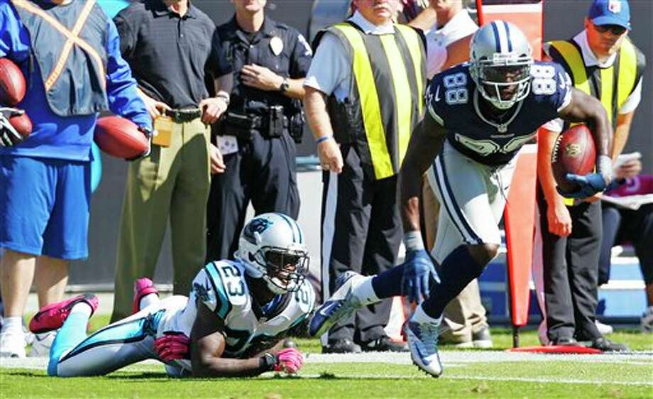 Dallas Cowboys wide receiver Dez Bryant (88) moves past Carolina Panthers free safety Sherrod Martin (23) during the first half of an NFL football game, Sunday, Oct. 21, 2012, in Charlotte. (AP Photo/Chuck Burton) Photo: Chuck Burton, Associated Press / AP