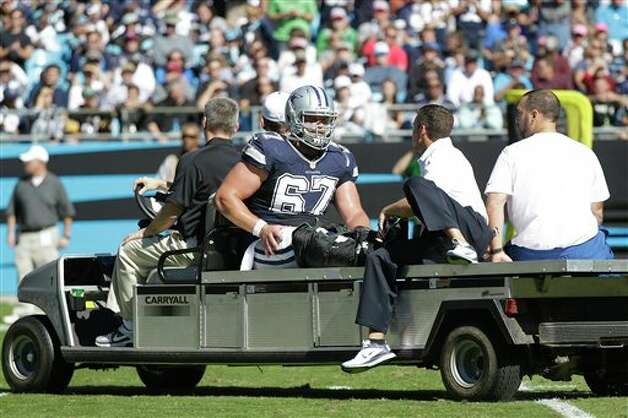 Dallas Cowboys center Phil Costa dislocated his right ankle against the Carolina Panthers on Oct. 21 and has not returned. Photo: Chuck Burton, Associated Press / AP