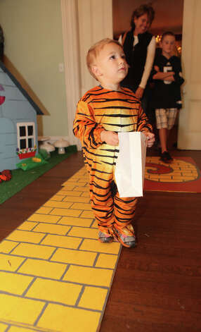 "Robert Sammons, 2, enters the Auxiliary of Ahlbin Centers for Rehabilitation's ""Enchanted Castle"" at the Burr Mansion in Fairfield, Conn. on Sunday, October 21, 2012. The storybook experience is open Wednesday October 24 through Monday October 29. Photo: B.K. Angeletti / Connecticut Post freelance B.K. Angeletti"