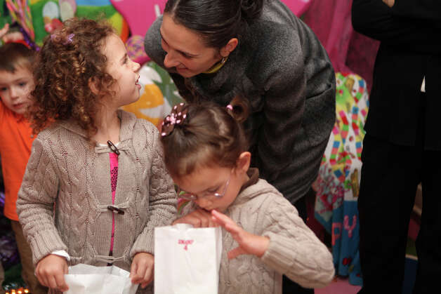 "Olivia Szczerba, 4, of Shelon, left, her mother, Isabella, and her sister, Kayla, 2, attend the Auxiliary of Ahlbin Centers for Rehabilitation's ""Enchanted Castle"" at the Burr Mansion in Fairfield, Conn. on Sunday, October 21, 2012. The storybook experience is open Wednesday, October 24, through Monday, October 29. Photo: B.K. Angeletti / Connecticut Post freelance B.K. Angeletti"