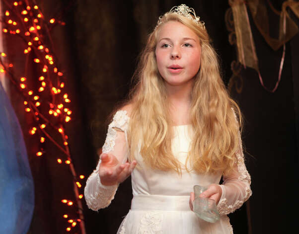 "Cinderella, Kerrie Ullman, 13, tells her story to children at the Auxiliary of Ahlbin Centers for Rehabilitation's ""Enchanted Castle"" at the Burr Mansion in Fairfield, Conn. on Sunday, October 21, 2012. The storybook experience is open Wednesday, October 24, through Monday, October 29. Photo: B.K. Angeletti / Connecticut Post freelance B.K. Angeletti"