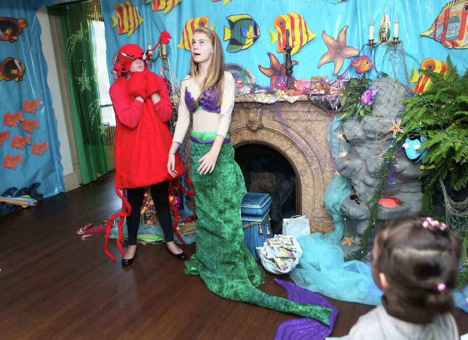 "Sebastian, Sarah Kulaga, 13, left, and Ariel, Julia Rachel, 12,  tell heir story to children at the Auxiliary of Ahlbin Centers for Rehabilitation's ""Enchanted Castle"" at the Burr Mansion in Fairfield, Conn. on Sunday, October 21, 2012. The storybook experience is open Wednesday, October 24, through Monday, October 29. Photo: B.K. Angeletti / Connecticut Post freelance B.K. Angeletti"