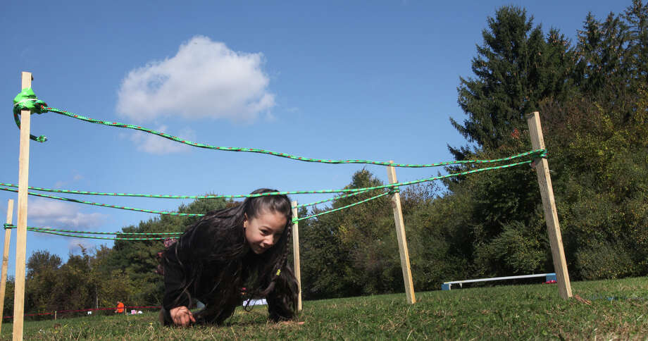 Christina Castellinin, 8, of Derby,  runs through an obstacle course at the VITAHLS (Valley Initiative to Advance Health & Learning in Schools) Family Fun Day at Emmett O'Brien in Ansonia, Conn. on Sunday, October 21, 2012. VITAHLS is a new community partnering Griffin Hospital, Yale-Griffin Prevention Research Center, and the Valley School Districts in an effort to reduce childhood obesity and promote the health, well-being, and academic readiness of students. Photo: B.K. Angeletti / Connecticut Post freelance B.K. Angeletti
