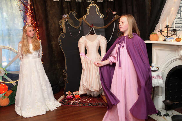 "Cinderella, Kerrie Ullman, 13, left, and Fairy Godmother, Claire Donlan, 12, tell their story to children at the Auxiliary of Ahlbin Centers for Rehabilitation's ""Enchanted Castle"" at the Burr Mansion in Fairfield, Conn. on Sunday, October 21, 2012. The storybook experience is open Wednesday, October 24, through Monday, October 29. Photo: B.K. Angeletti / Connecticut Post freelance B.K. Angeletti"
