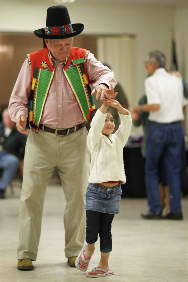 Ledislav Zezula, 79, dances with four-year-old Grace Castro during the Bexar County Chapter of The Czech Heritage Society of Texas annual Czech Heritage Festival at Knights of Columbus on Rigsby Avenue, Sunday, Oct. 21, 2012. Music by Chris Rybak, food, costumes, genealogy displays and a silent auction were part of the festival. Photo: Jerry Lara, San Antonio Express-News / © 2012 San Antonio Express-News