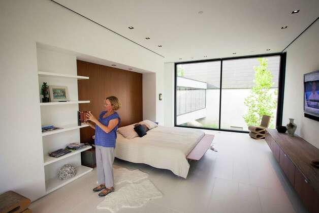 Natasha Bleyzer stands in a bedroom with her 15,000-square-foot house overlooking a wooded nature preserve on the banks of Buffalo Bayou and designed by the firm Stern & Bucek, Wednesday, Oct. 10, 2012, in Houston.  The Bleyzer House is on this year's American Institute of Architects Home Tour 2012. Photo: Michael Paulsen, Houston Chronicle / © 2012 Houston Chronicle