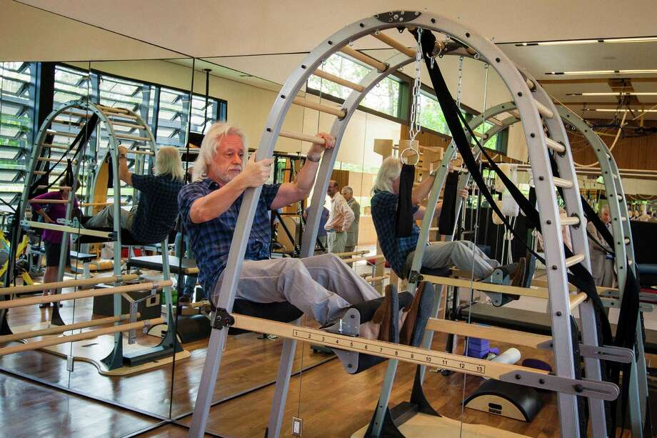 Michael Bleyzer's uses his exercise equipment within his private gym at his 15,000-square-foot house overlooking a wooded nature preserve on the banks of Buffalo Bayou and designed by the firm Stern & Bucek, Wednesday, Oct. 10, 2012, in Houston.  The Bleyzer House is on this year's American Institute of Architects Home Tour 2012. Photo: Michael Paulsen, Houston Chronicle / © 2012 Houston Chronicle