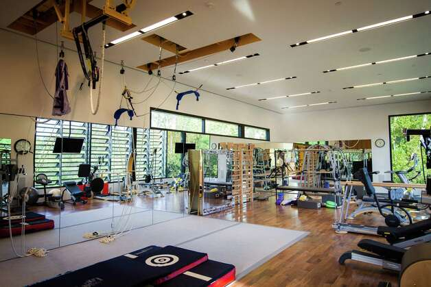 Michael Bleyzer's private gym at his 15,000-square-foot house overlooking a wooded nature preserve on the banks of Buffalo Bayou and designed by the firm Stern & Bucek, Wednesday, Oct. 10, 2012, in Houston.  The Bleyzer House is on this year's American Institute of Architects Home Tour 2012. Photo: Michael Paulsen, Houston Chronicle / © 2012 Houston Chronicle