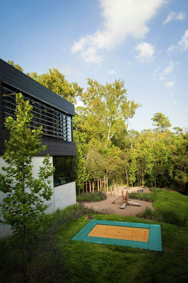 A trampoline outside Michael Bleyzer's private gym at his  15,000-square-foot house overlooking a wooded nature preserve on the  banks of Buffalo Bayou and designed by the firm Stern & Bucek,  Wednesday, Oct. 10, 2012, in Houston.  Photo: Michael Paulsen, Houston Chronicle / © 2012 Houston Chronicle
