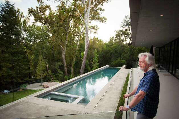 Michael Bleyzer stands outside his 15,000-square-foot house overlooking a wooded nature preserve on the banks of Buffalo Bayou and designed by the firm Stern & Bucek, Wednesday, Oct. 10, 2012, in Houston.  The Bleyzer House is on this year's American Institute of Architects Home Tour 2012. Photo: Michael Paulsen, Houston Chronicle / © 2012 Houston Chronicle