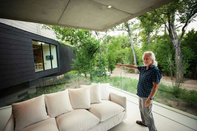 Michael Bleyzer stands inside his 15,000-square-foot house overlooking a wooded nature preserve on the banks of Buffalo Bayou and designed by the firm Stern & Bucek, Wednesday, Oct. 10, 2012, in Houston.  The Bleyzer House is on this year's American Institute of Architects Home Tour 2012. Read more about the house in Lisa Gray's column. Photo: Michael Paulsen, Houston Chronicle / © 2012 Houston Chronicle