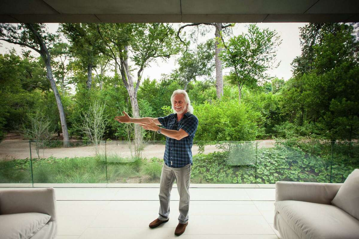 Michael Bleyzer in 2012, showing off the view of Buffalo Bayou from his 15,000-square-foot house. Bleyzer and his wife arrived in the U.S. in 1978, bringing their suitcases, a young daughter, and the $2,500 debt they'd incurred to buy plane tickets.