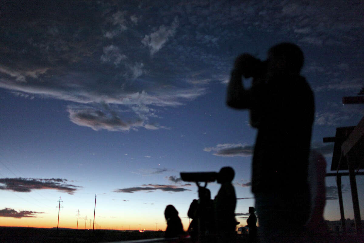People look for the Marfa Lights on Saturday Oct. 20, 2012 at the Marfa Lights Viewing Area, nine miles east of Marfa, Tx.