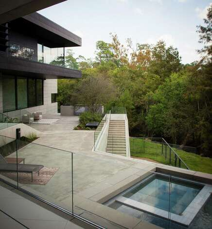 Exterior shot of Michael and Natasha Bleyzer's 15,000-square-foot house overlooking a wooded nature preserve on the banks of Buffalo Bayou and designed by the firm Stern & Bucek, Wednesday, Oct. 10, 2012, in Houston.  The Bleyzer House is on this year's American Institute of Architects Home Tour 2012. Photo: Michael Paulsen, Houston Chronicle / © 2012 Houston Chronicle