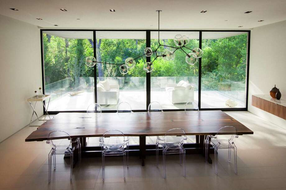 A dinning area inside Michael and Natasha Bleyzer's 15,000-square-foot house overlooking a wooded nature preserve on the banks of Buffalo Bayou and designed by the firm Stern & Bucek, Wednesday, Oct. 10, 2012, in Houston.  The Bleyzer House is on this year's American Institute of Architects Home Tour 2012. Photo: Michael Paulsen, Houston Chronicle / © 2012 Houston Chronicle