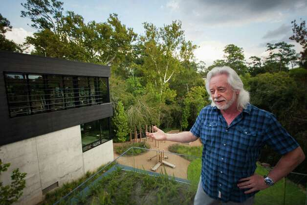 Michael Bleyzer stands inside his 15,000-square-foot house overlooking a wooded nature preserve on the banks of Buffalo Bayou and designed by the firm Stern & Bucek, Wednesday, Oct. 10, 2012, in Houston.  The Bleyzer House is on this year's American Institute of Architects Home Tour 2012. Photo: Michael Paulsen, Houston Chronicle / © 2012 Houston Chronicle