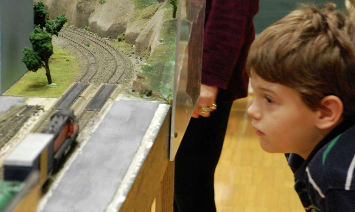 Ethan Durham of Fairfield watches with wonder as a scale-model train cruises past at the Housatonic Model Railway Club's 26th annual train show Sunday at Fairfield Ludlowe High School.