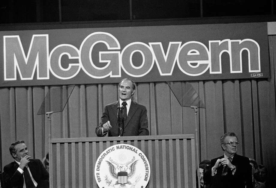 FILE - In this July 14, 1972 file photo, Sen. George S. McGovern makes his acceptance speech at the Democratic National Convention in Miami Beach. At left is his running mate, Sen. Thomas F. Eagleton of Missouri, and at right, convention chairman Lawrence F. O'Brien.  A family spokesman says, McGovern, the Democrat who lost to President Richard Nixon in 1972 in a historic landslide, has died at the age of 90. According to the spokesman,  McGovern died Sunday, Oct. 21, 2012 at a hospice in Sioux Falls, surrounded by family and friends. (AP Photo) Photo: Associated Press / AP